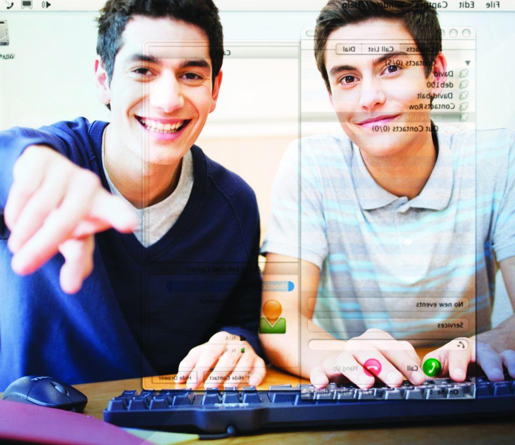 Two teenage boys using a computer